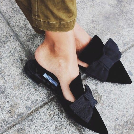 Flat black mules with grossgrain bows