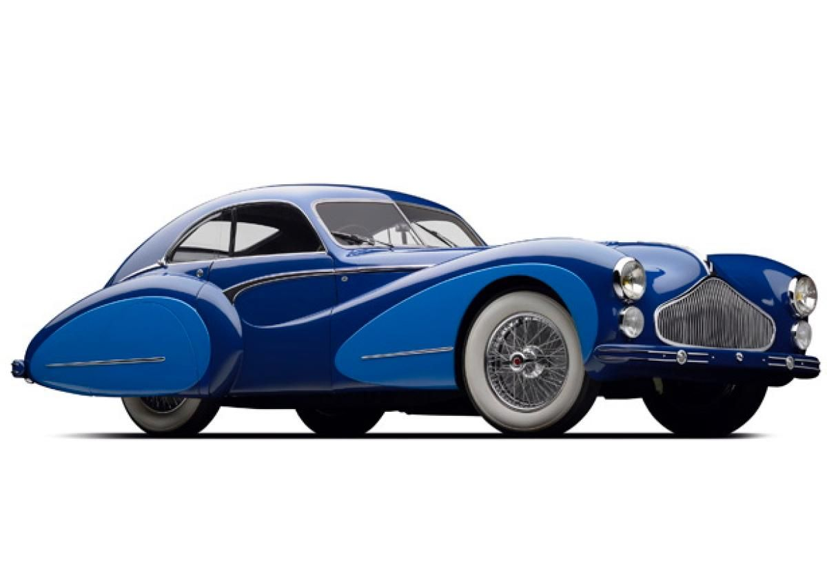 A T26 Grand Sport model won the 24 Hour Race at Le Mans in 1950. With a top speed of 125 mph, the chassis came with the ability for customers to choose different body styles, such as this Saoutchik-designed model. The body features a two-tone blue color scheme with chrome accents and teardrop fenders, which enclose the rear wheels.