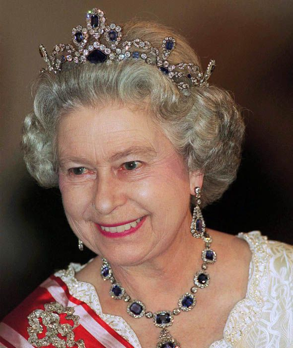 3bef52ea010 Queen Elizabeth II wearing her much loved Modern Sapphire collection