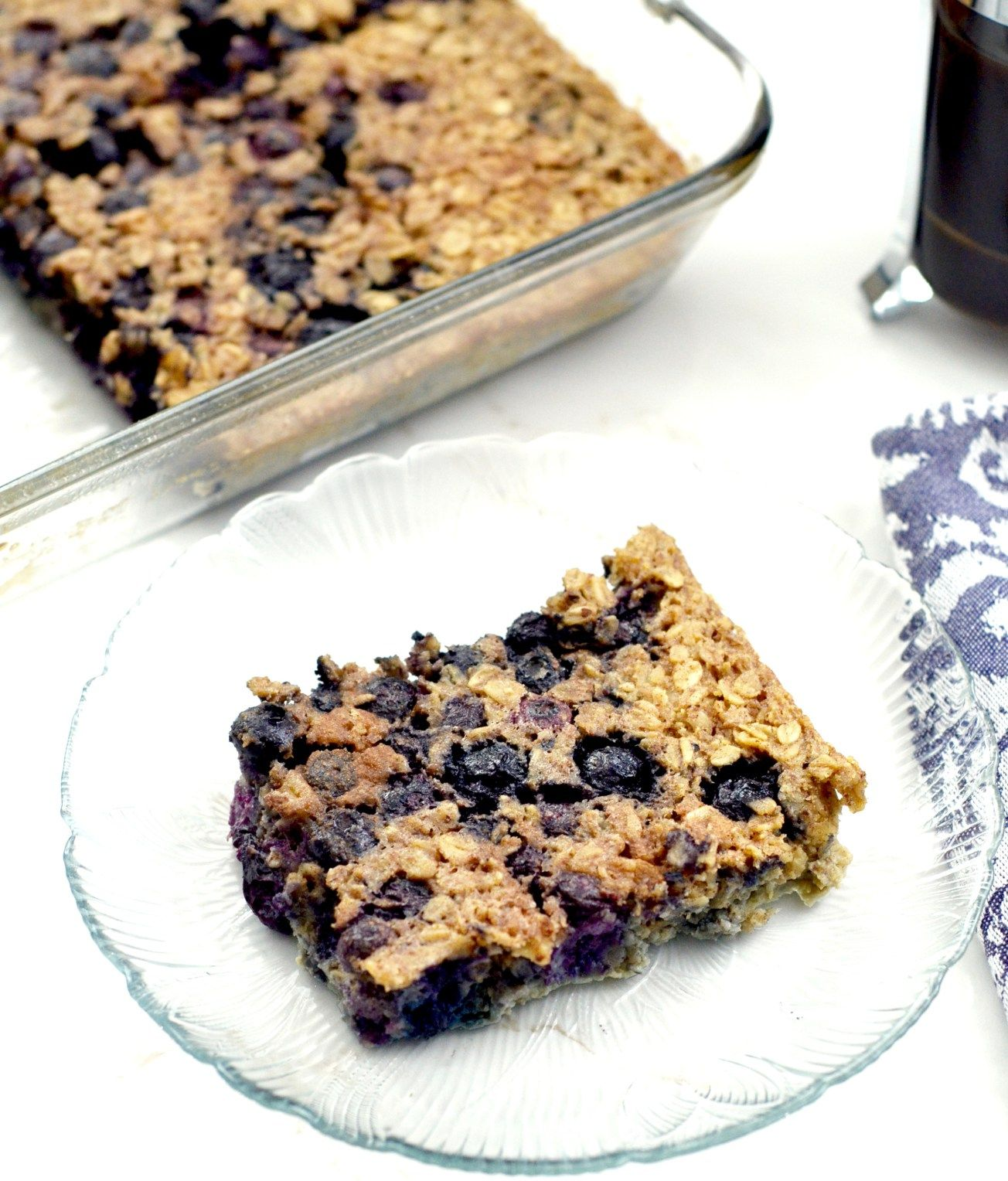 Healthy baked blueberry oatmeal recipe! The addition of Greek yogurt and almond meal make this a protein-rich breakfast! Plus it's gluten-free, refined-sugar free and feeds a crowd!