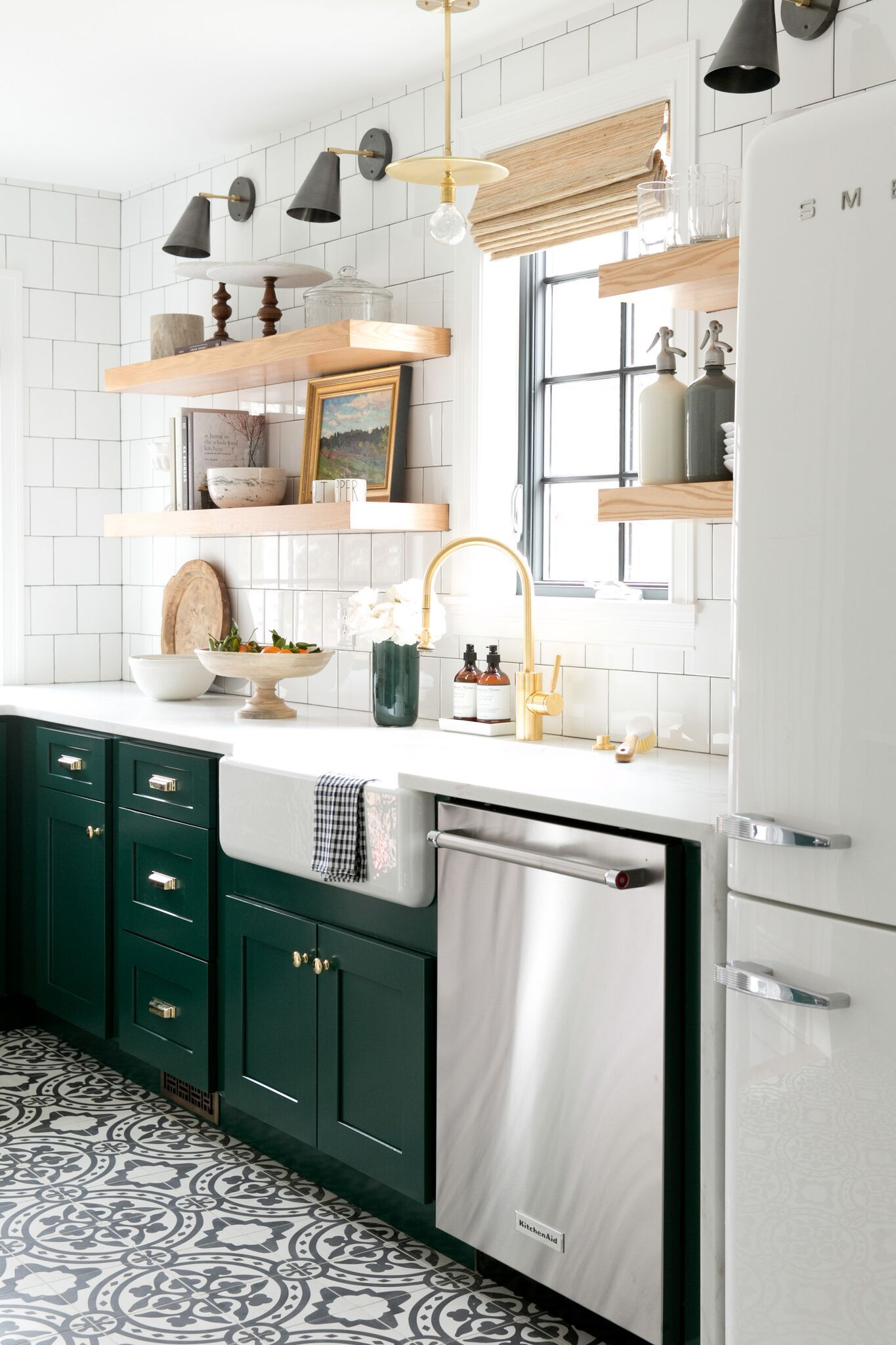 Modern vintage kitchen with cabinets in benjamin moores forest green open shelving and cement tile