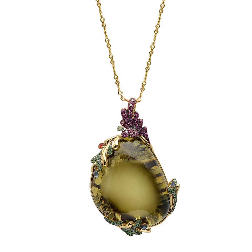 18K yellow gold pendant with 0.06 carat round brilliant cut diamonds, 1.55 carat tsavorite, 1.16 carat ruby, 1.19 carat sapphires and 38.19 grams of center amber. #michaeljohnjewelry
