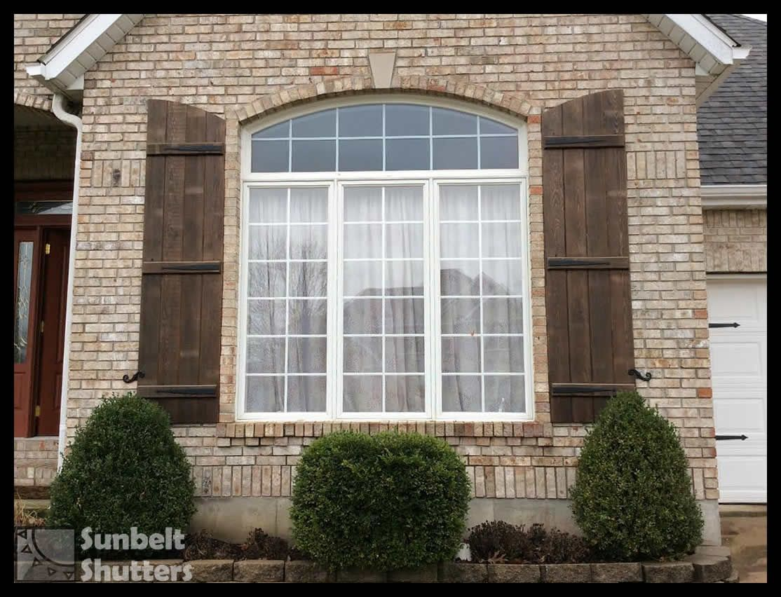 Sunbelt Shutters Arched Top Board Batten shutters are stained
