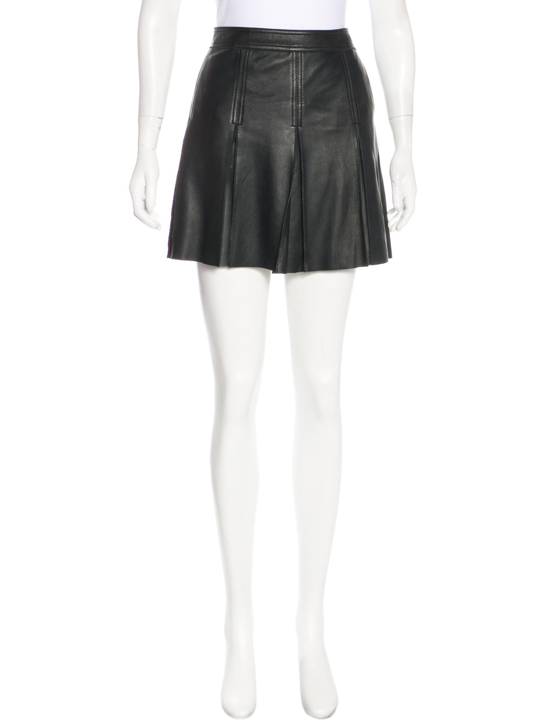 39507daa4b Black Polo Ralph Lauren leather mini skirt with tonal stitching throughout,  pleated accents at front and back and concealed button closures at side.