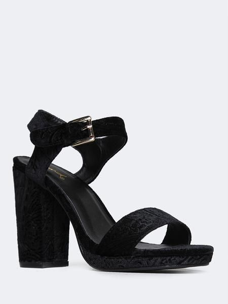 3ab400382e8 This velvet sandal is made with an open toe and mini platform. Also made  with a wrapped block heel and ankle strap with ...
