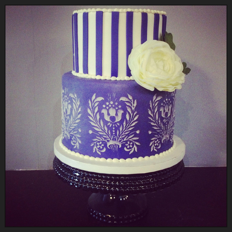 Purple wedding cake with white damask stencil camius cake co