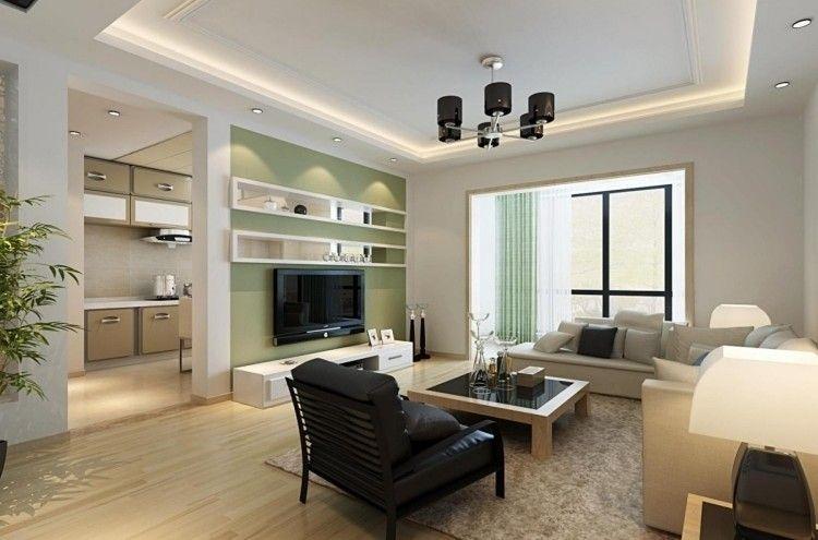 Olivengrüne Akzentwand und weiße Wandregale im Wohnzimmer