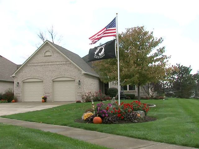 A Local S Desire To Keep Flagpole In Their Front Yard So They Can Fly An American Flag Has Sparked Controversy Greenfield Subdivision