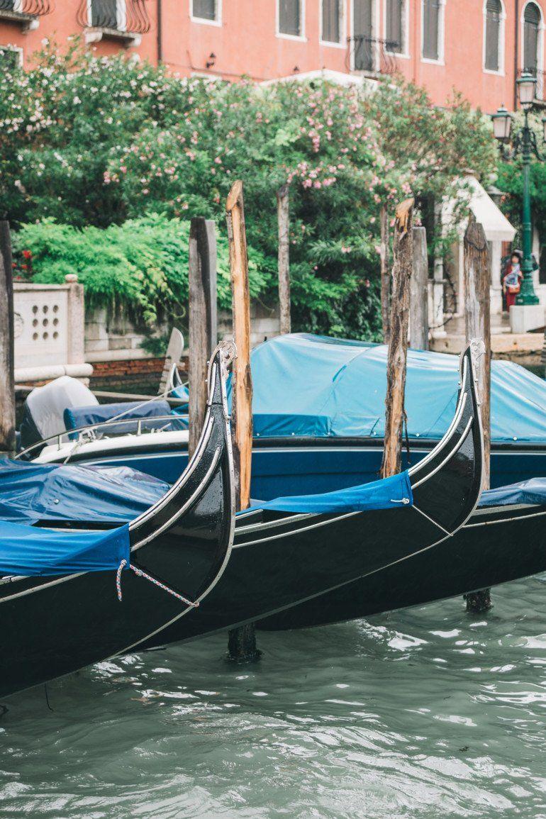 Gondolas anchored on canal in venice italy free photo
