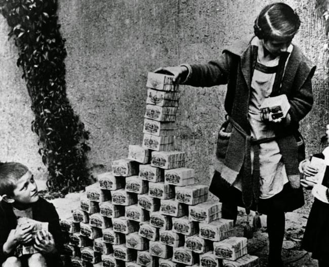 German Kids Playing with Money Stacks