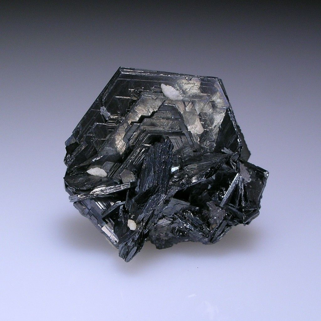 Polybasite, [Ag9CuS4] [(Ag,Cu)6(Sb,As)2S7], San Guillermo Vein, San Luis Shaft, Proano Mine, Mun. de Fresnillo, Zacatecas, Mexico. Dimensions: 2 x 2 x 1.4 cm. A sharp, lustrous, pseudo-hexagonal crystal, 2.0 cm across, with minor calcite, quartz and stephanite. Copyright: © Allan Young