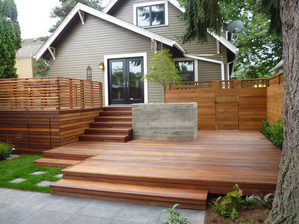 Horizontal cedar fence deck with wood slat railing ideas for Garden decking fencing