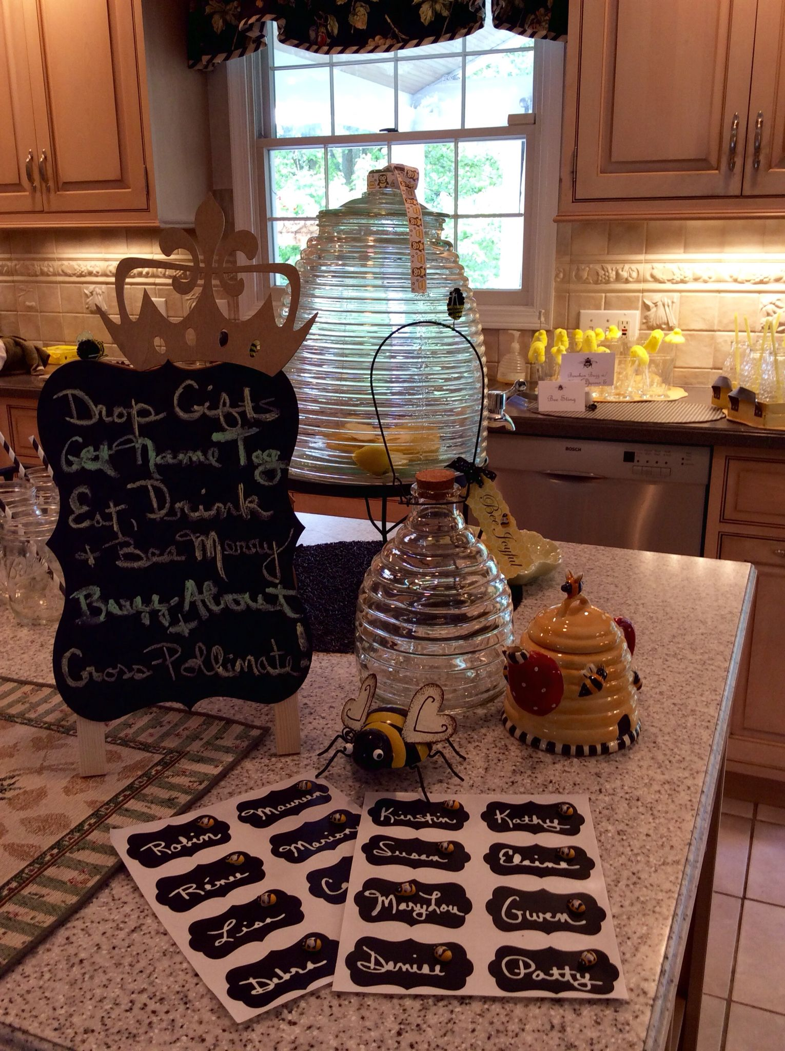 Kitchen island name - Kitchen Island Served As A Welcome Center For Guests And Included Chalk Board Looking Name Tags