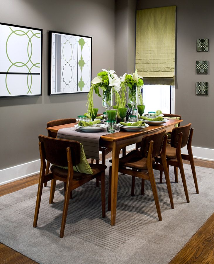 Small dining room with earth tones and green accents Area Rugs