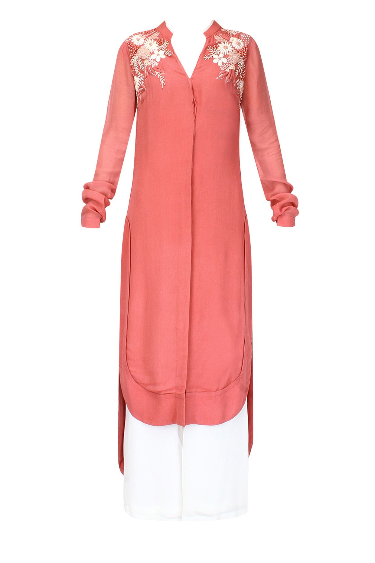 Simple styled tunic with embroidery around neck, leather