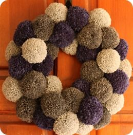 Another Pompom Wreath - oh yes.  this WILL hang on my door.  Will be different colors but it will be there.