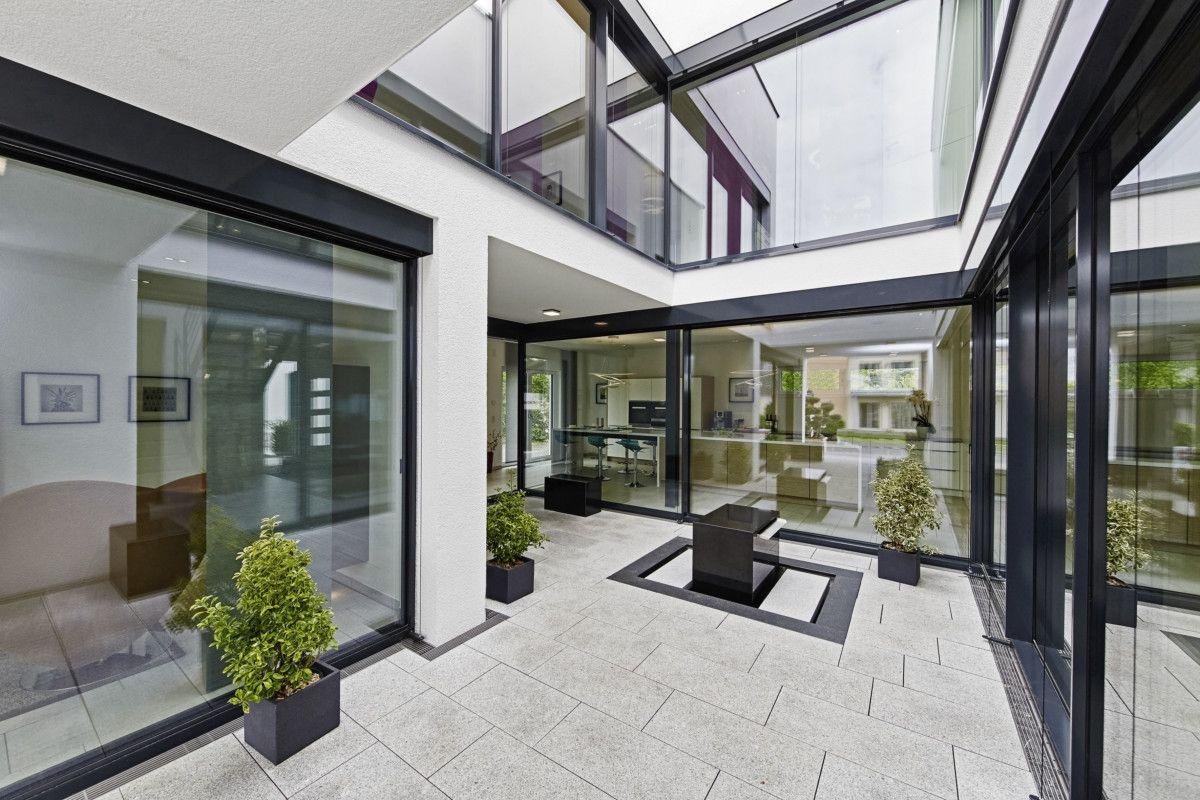 patio architektur einfamilienhaus innenarchitektur haus bad vilbel mit atrium okal fertighaus. Black Bedroom Furniture Sets. Home Design Ideas
