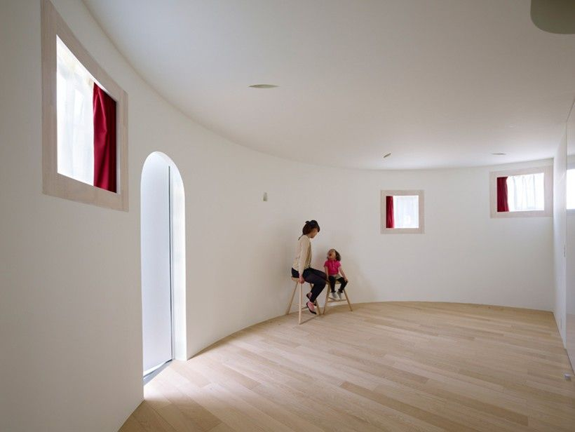 With the aid of a flexible metal track and curved drywall, framing a ...
