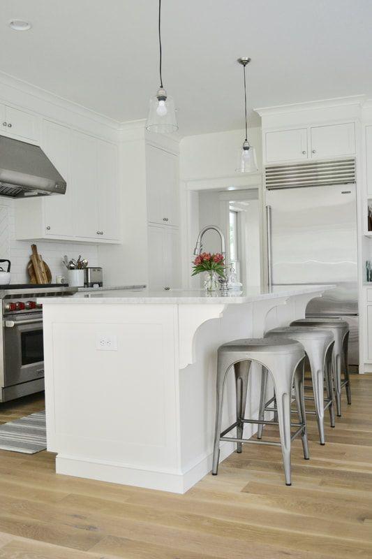 Modern Farmhouse Kitchen - white kitchen, white marble, wood floors ...
