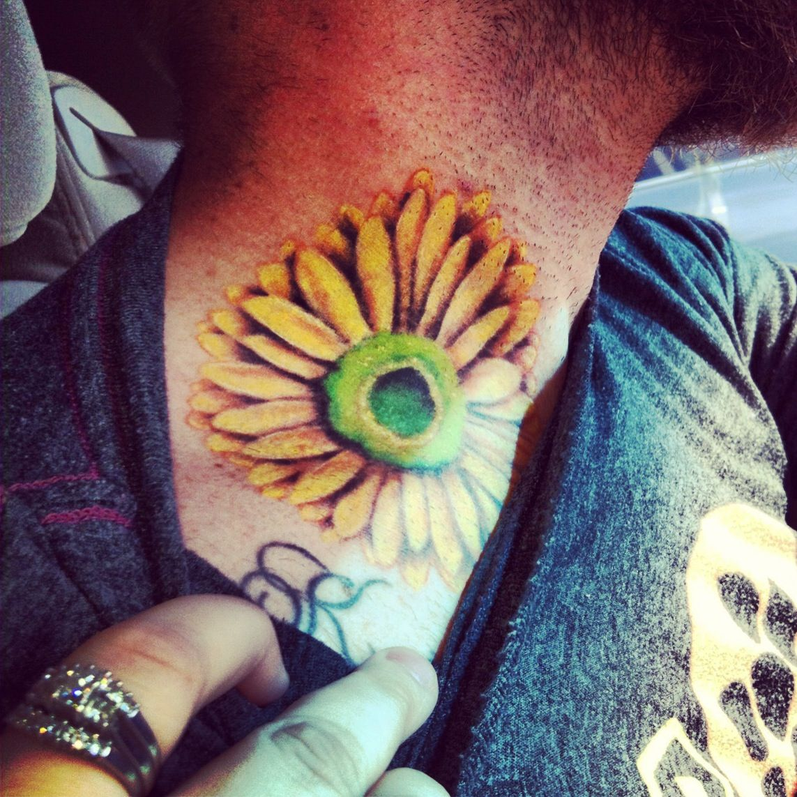 Name tattoo ideas hubby got my favorite flower tattooed next to my name    tattoo