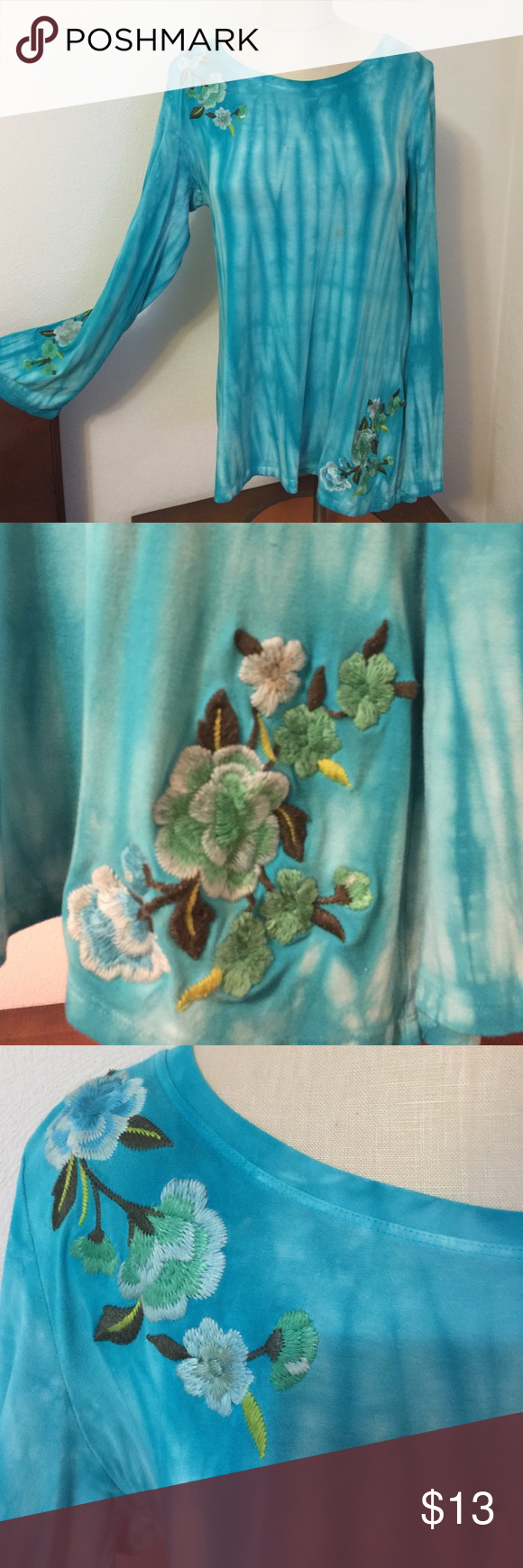 Embroidered flowers on a long sleeve top Embroidered flowers on a long sleeve top dyed blue. Like New! Flared sleeves extra long top to maybe match with skinny jeans. Thanks INC International Concepts Tops Tees - Long Sleeve