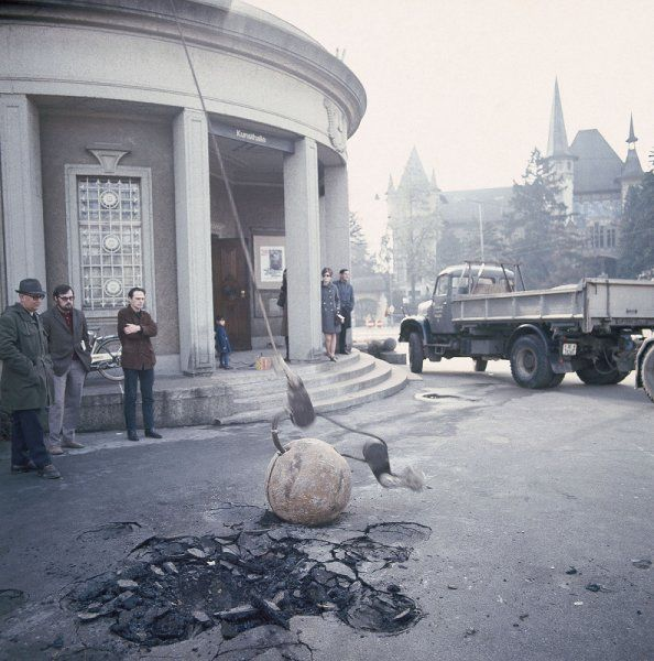 Michael Heizer and exhibition-maker Harald Szeemann observe the commission of Heizer's work Bern Depression outside the Kunsthalle Bern in 1969.