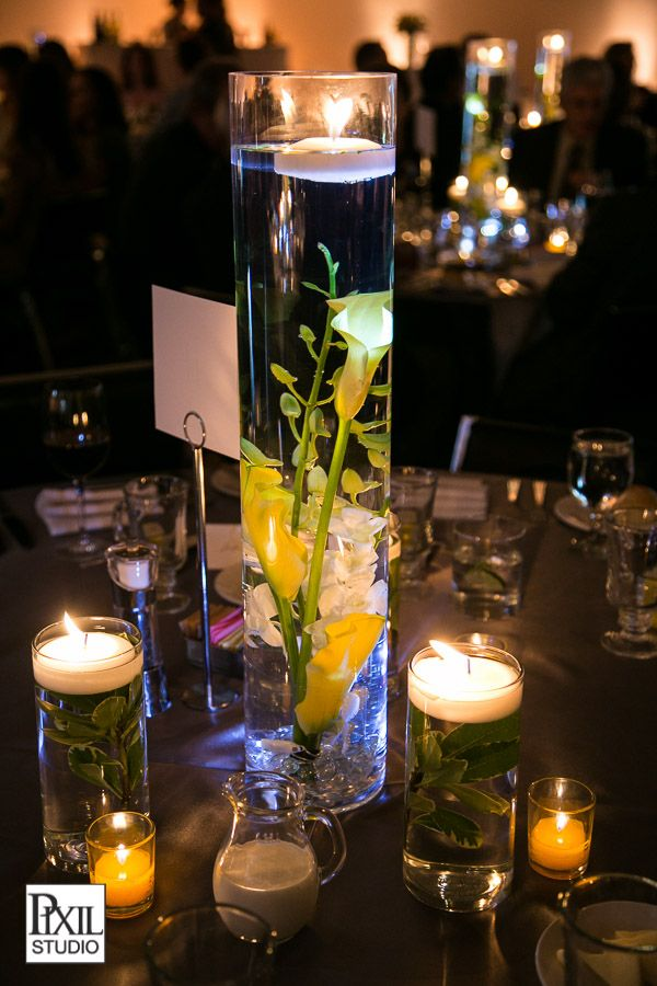 Yellow Flower Centerpieces Submerged In Water With Candle Light Denver Art Museum Wedding Storytellers Events Art Deco Wedding Flowers Art Deco Wedding Floating Candle Centerpieces