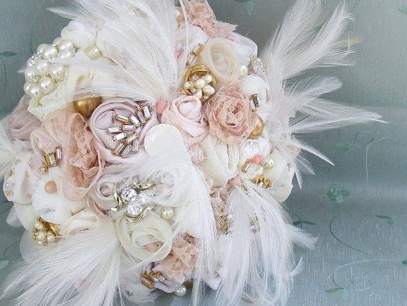 Bridal Broach Bouquet... you could use your peacock feathers Jess!