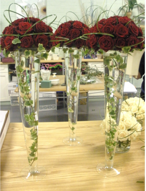 Red Roses In Tall Vases With Ivy Dont Like The Stem Loop De Loops