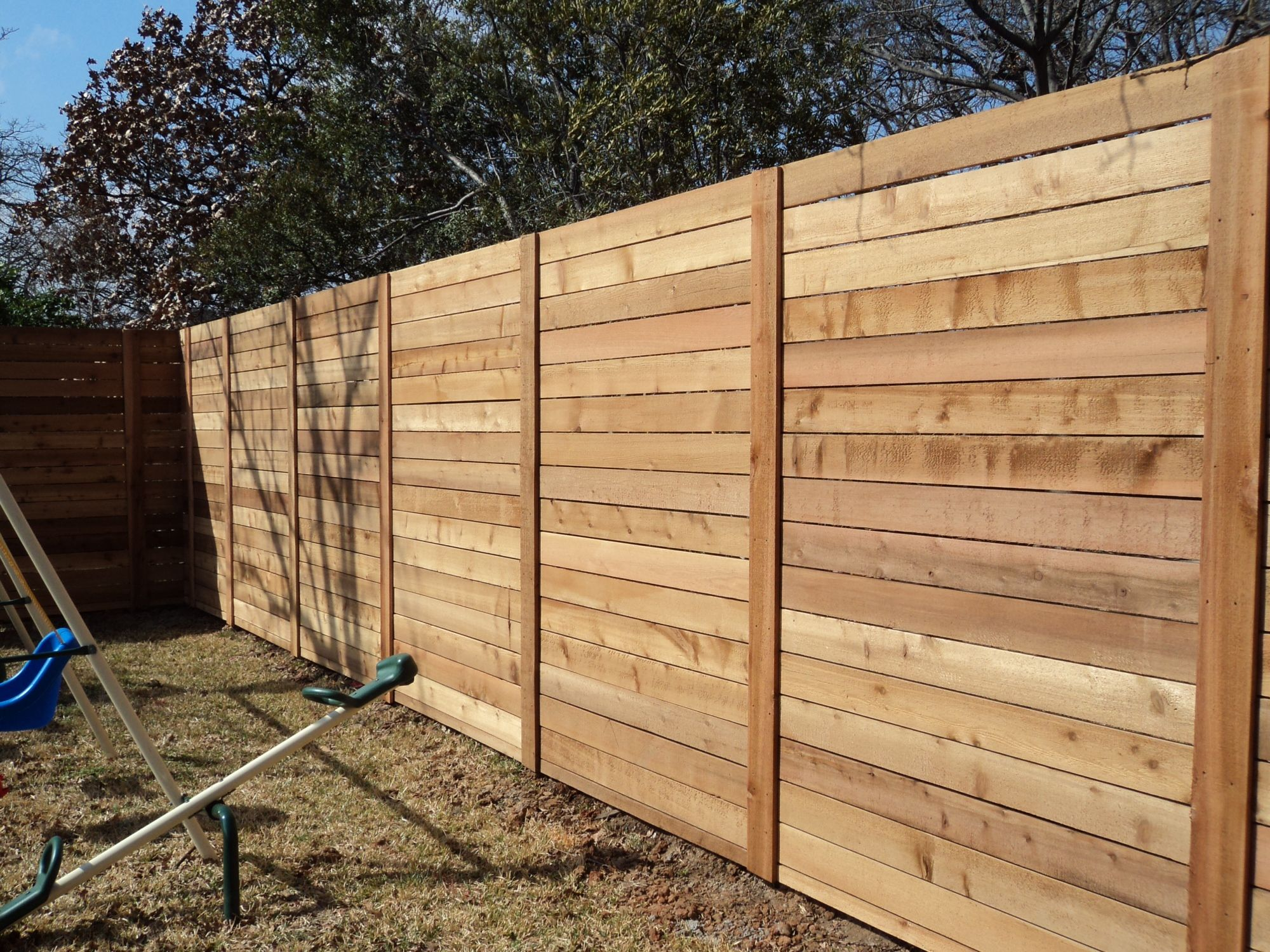 modern horizontal fence with stacked boards modern