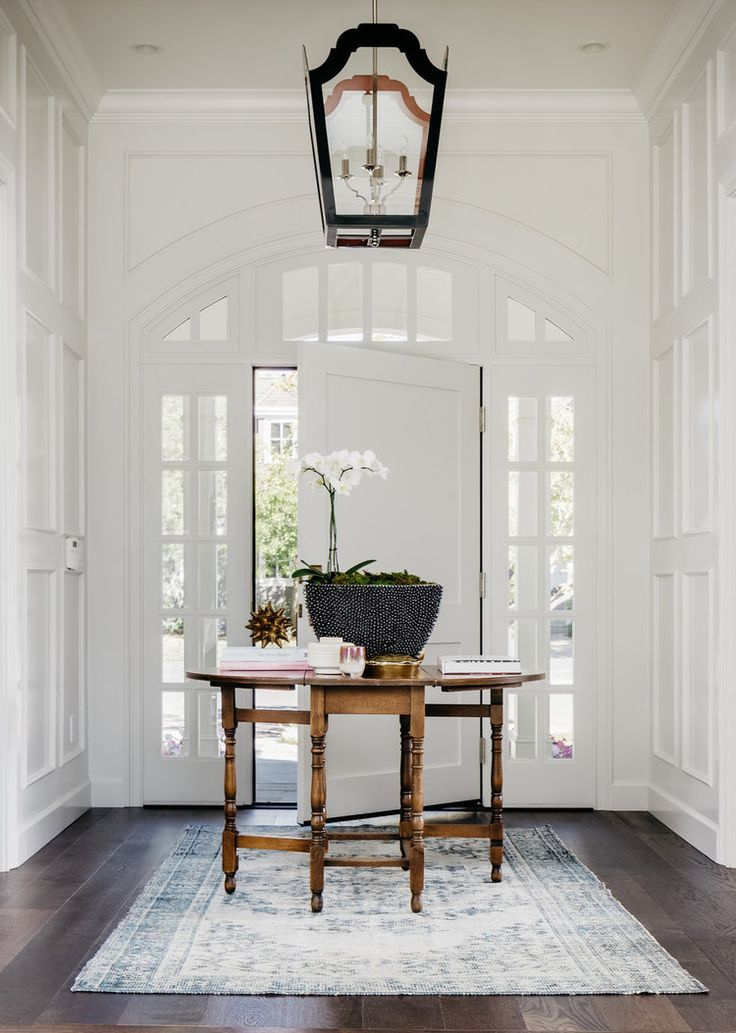 French inspired entryway with arched windows and perfect finish work! Evars  + Anderson Interior Design