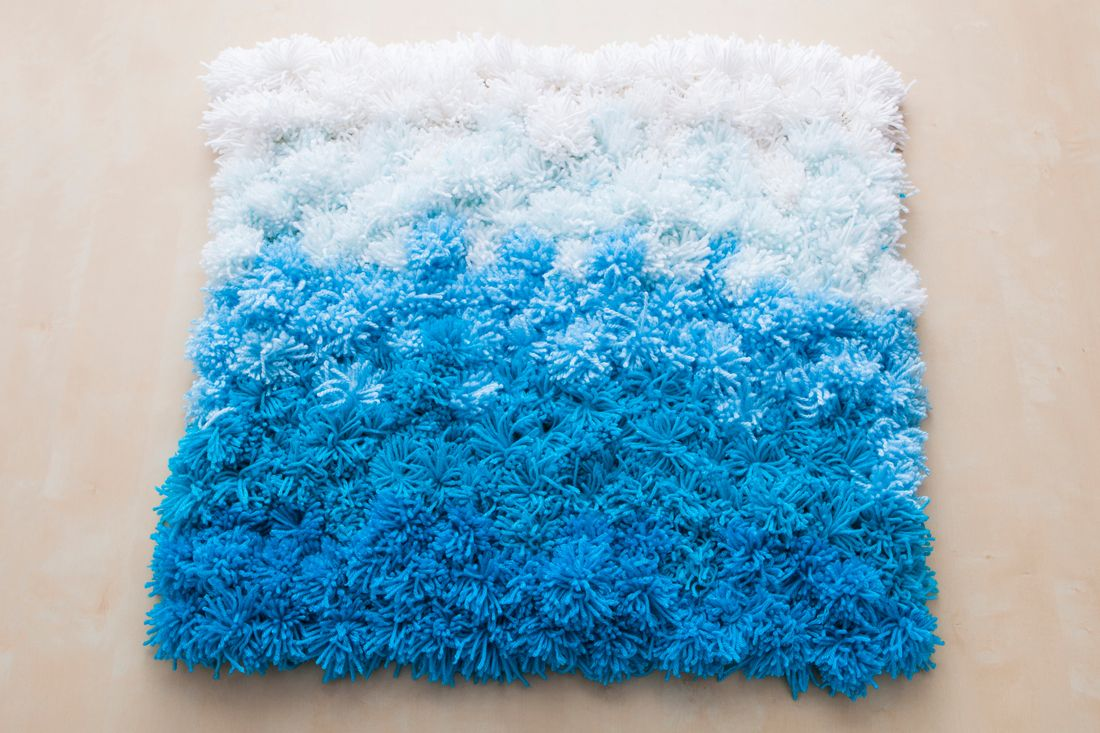 A Pom Rug Wall Hanging And Table Cover In One Via Brit
