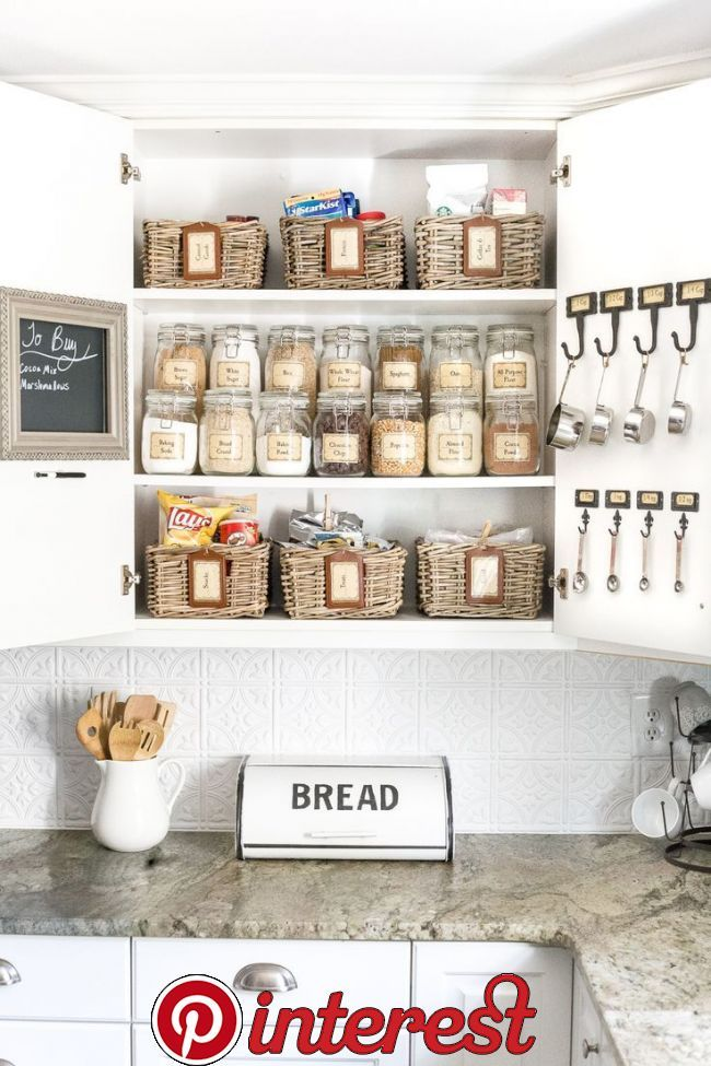 Pantry Cabinet Organization and Printable Labels   A cabinet gets a drastic organization makeover using inexpensive IKEA jars / baskets, hanging storage, and a free pantry label printable set. #organization