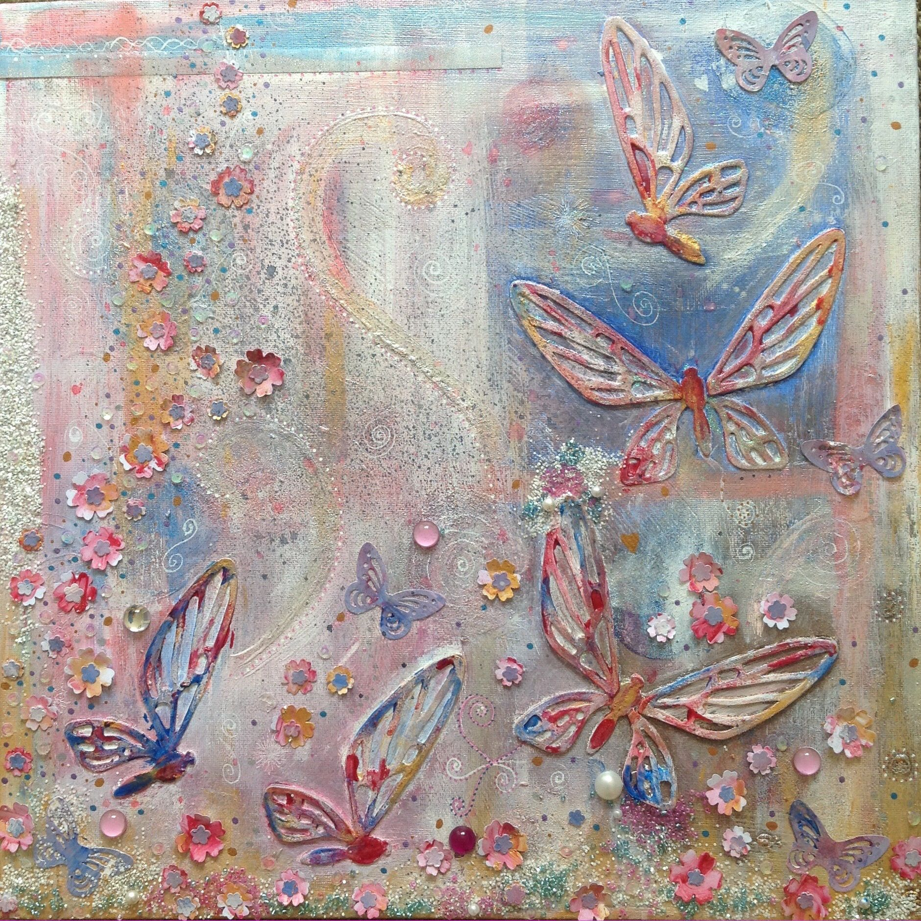 Mixed media, tim holtz die cut butterfly acrylic, wax, beads punched flowers, glass paint. For hospice wall