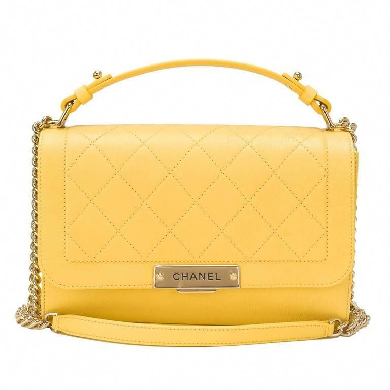 ac269adcdb55 For Sale on 1stdibs - Chanel Medium Label Click Flap bag of quilted and  smooth yellow grained calfskin leather and gold tone hardware.