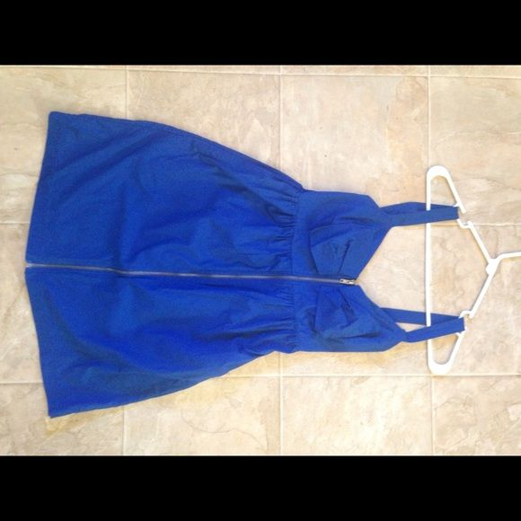 A Blue zip-up sun dress A Blue zip-up sun dress with the upper back smocked. It also has pockets. It's a very cute, but casual dress. Be Bop Dresses