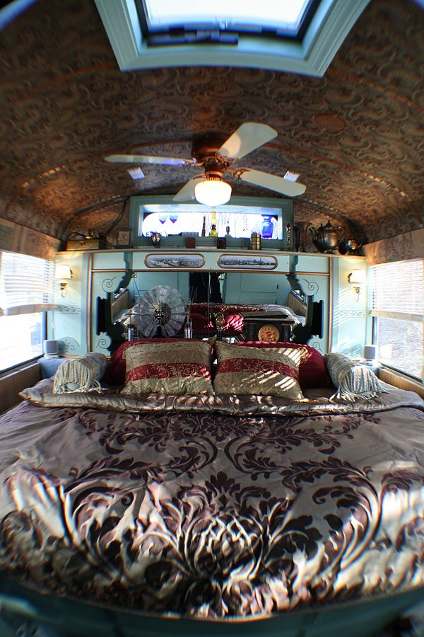 love the ceiling in this bus steampunk rv bedroom converted from an