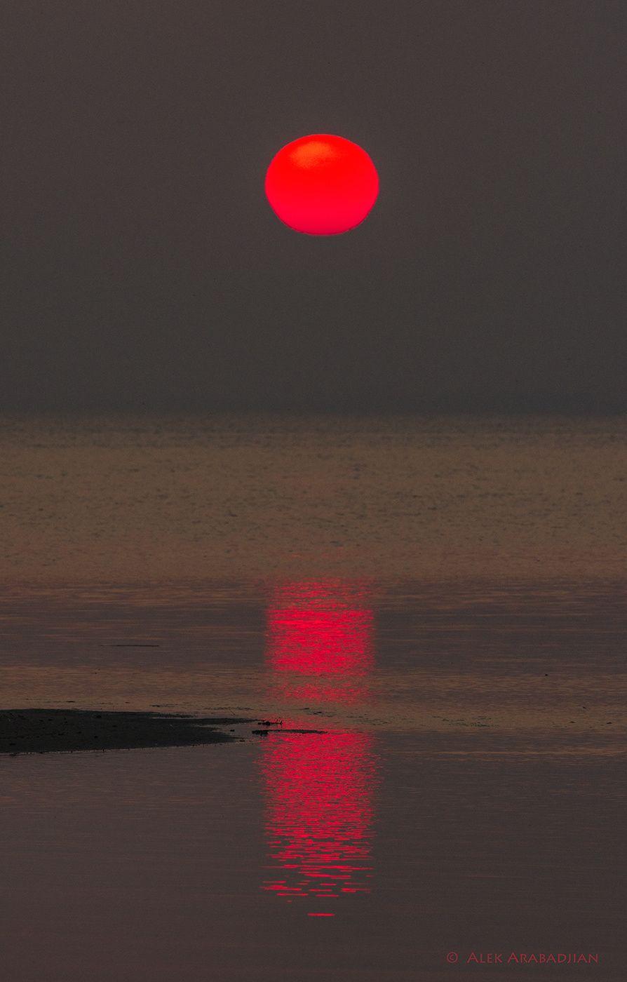 November Red - Red Sundown at the Meditarean Sea near Porto Lagos, Greece, by Alek Arabadjian...