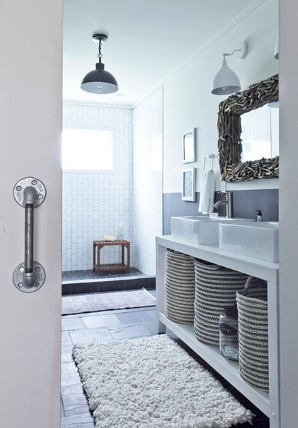 Nice shower / bathroom with black and white tiles/lights.