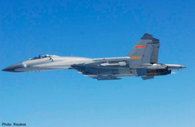 "Chinese Sukhoi SU-27 ""Flanker"" fighter flies over East China Sea,May 24,2014. Chinese fighter jets flew within a few dozen metres of Japanese military planes over the East China Sea, Japanese officials said on Sunday, prompting the defence minister to accuse Beijing of going ""over the top"" in its approach to disputed territory.Photo/report identifies as a Sukhoi,but most likely Shenyang J-11 domestically built, reengineered from Su-27SK air superiority fighter airframe."