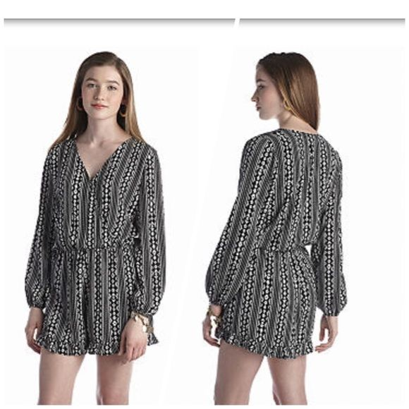Living Doll B&W Aztec biadere romper Living doll black and white beautiful Aztec biadere print romper. Features a plunging neckline that you can button or leave open. Add a small white belt for extra styling!!!! Only worn 1 time to a special event. Beautiful piece for the summer☀️ Living Doll Other
