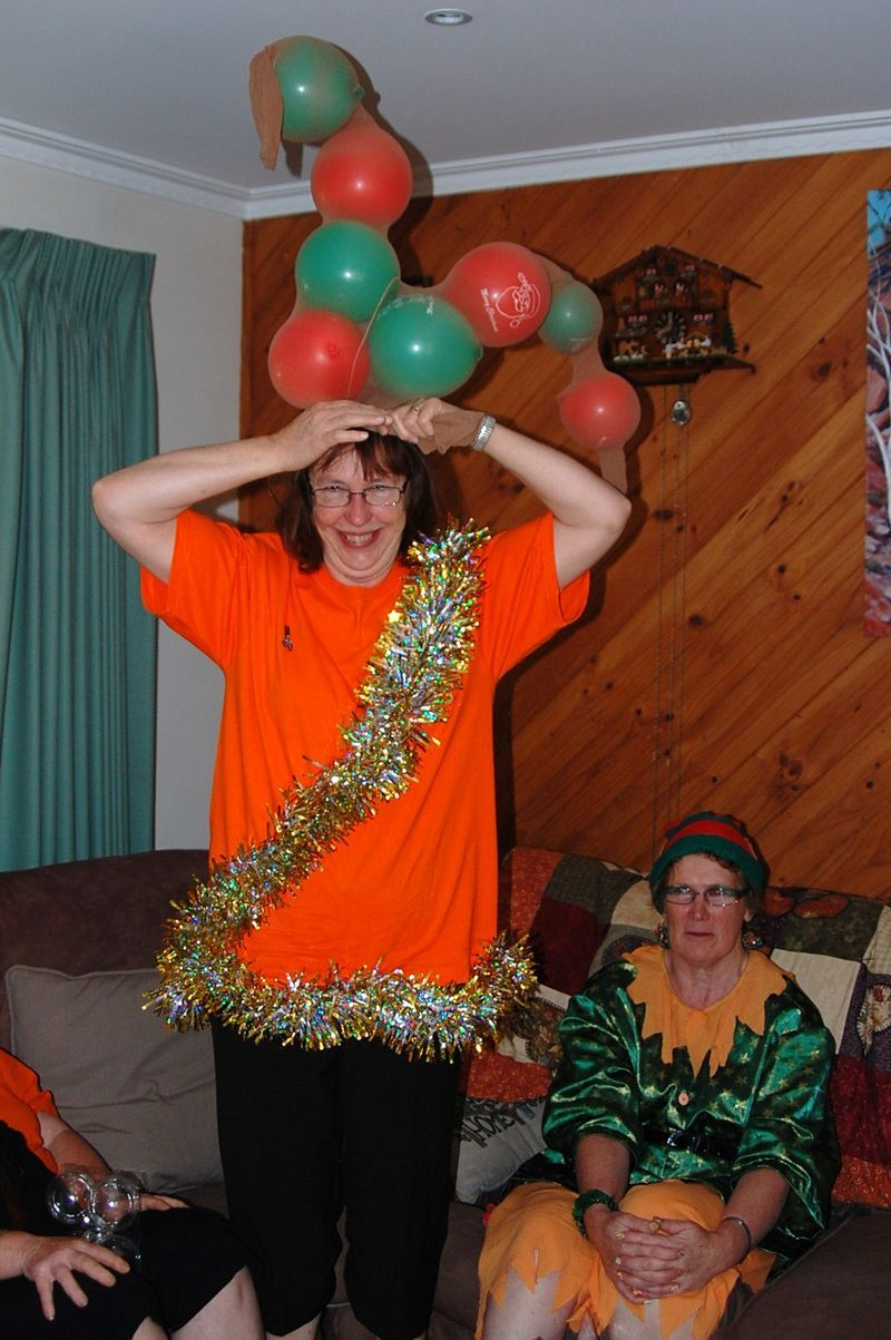 girl-stripping-reindeer-relay-with-balloons-pantyhose