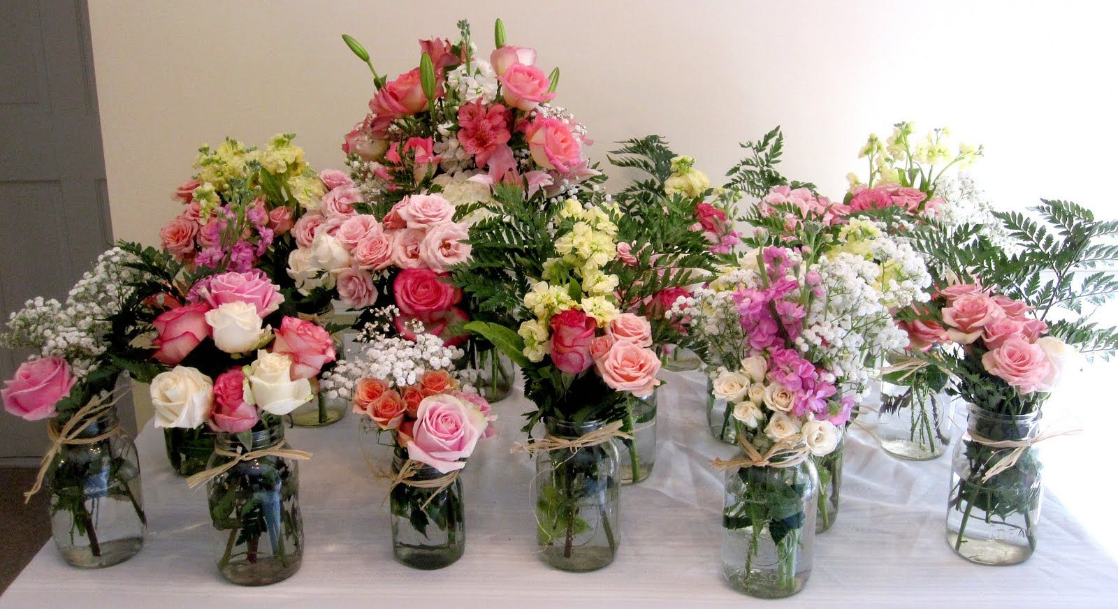 Country flower arrangements placed about mason jar