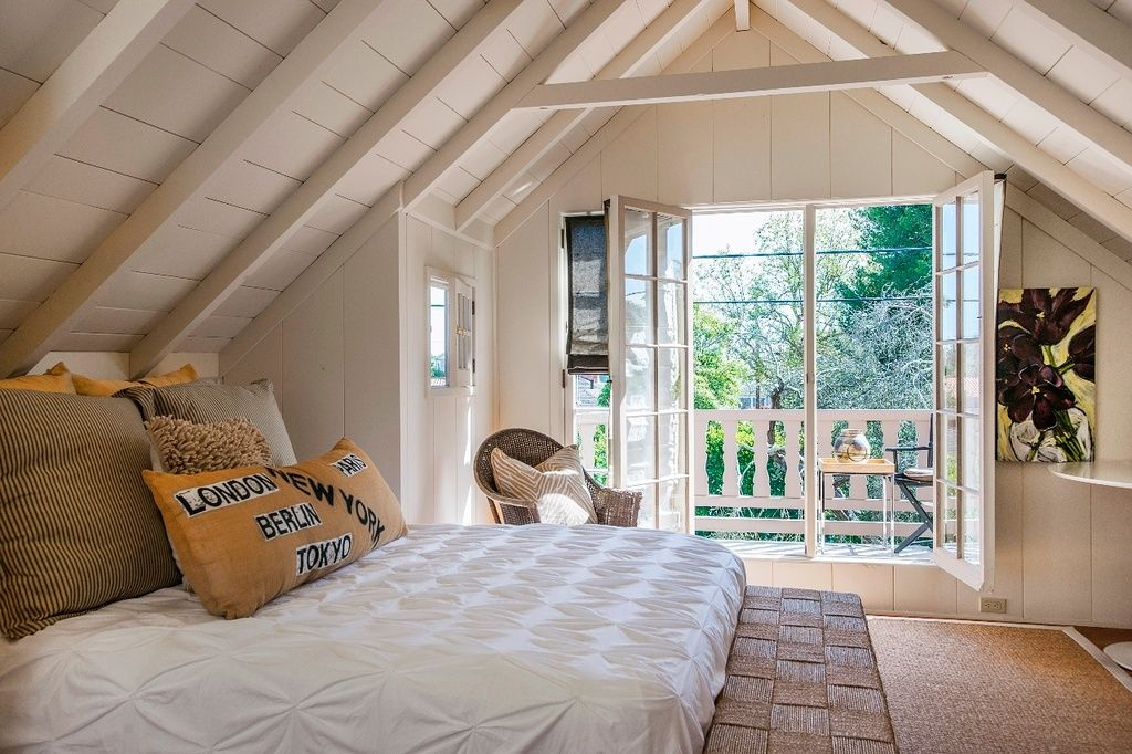 Cottage Guest Bedroom with Exposed beam, West Elm Organic