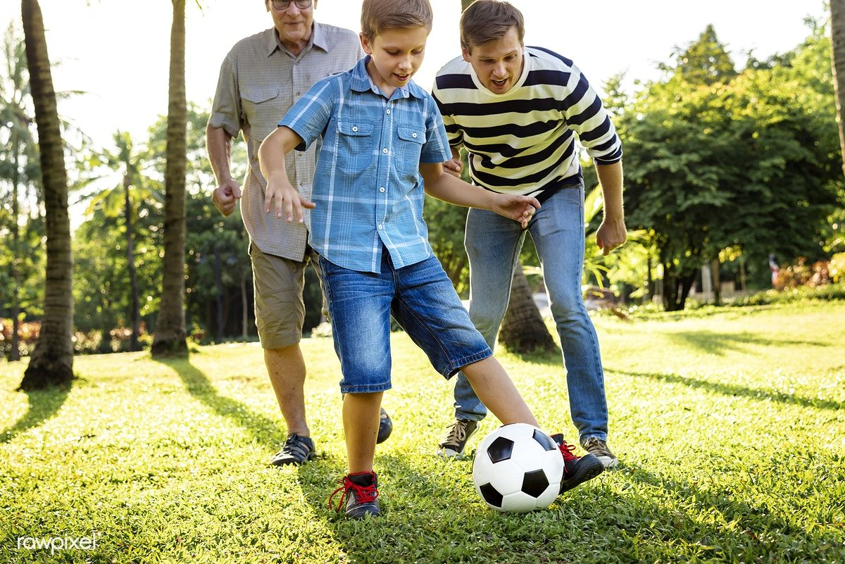 Download Premium Image Of Family Playing Football In The Garden 431187 Family Images Playing Football Football