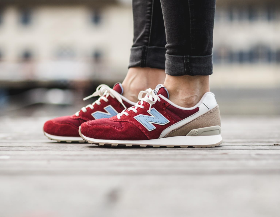 The New Balance 996 for women is rendered in a burgundy