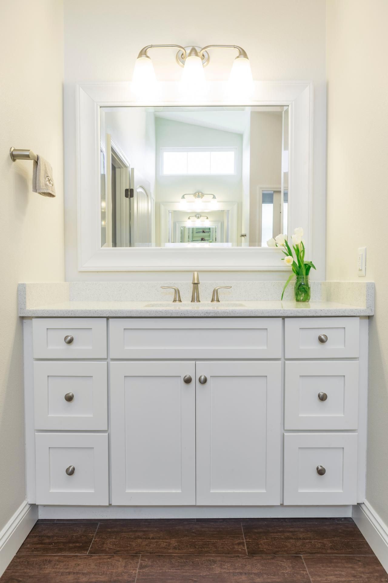 white shaker bathroom vanity. HGTV Invites You To Peek Inside This Transitional Bathroom With A Crisp White Vanity, Quartz Countertops And Wood-look Tile Floors. Shaker Vanity T