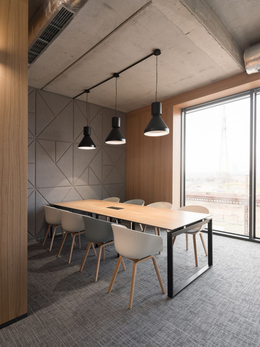 The grey and the wood gives this space a nice contrast look but also the design on the wall makes the contrast stick out even more officedesigns