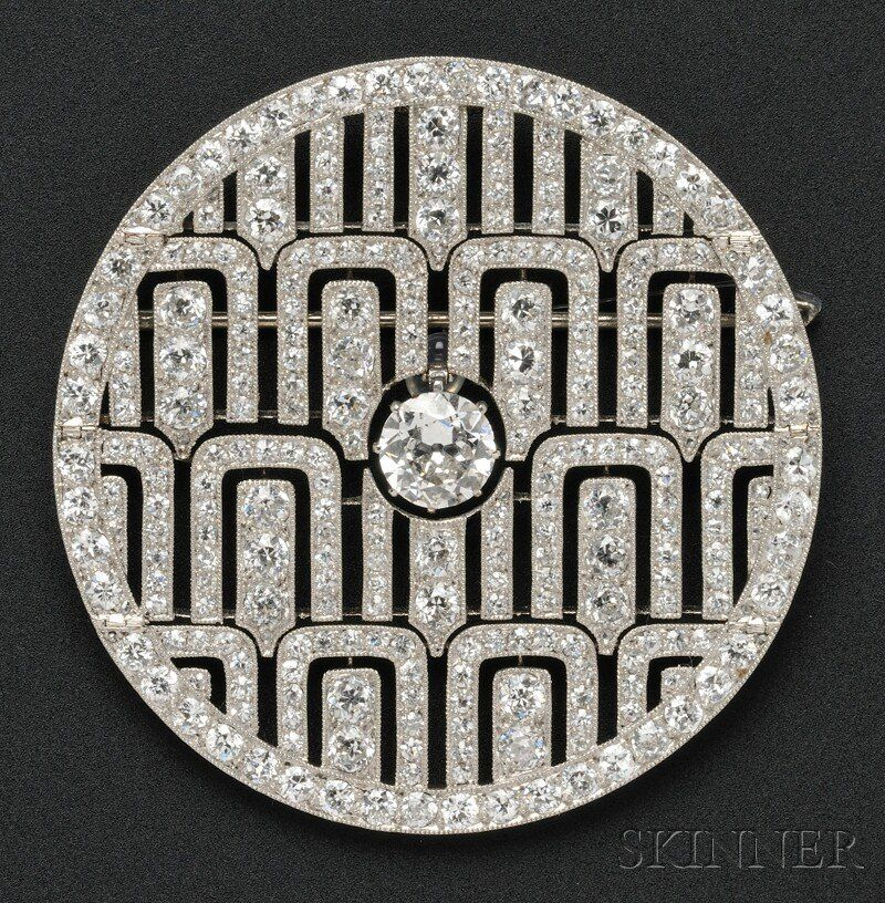 Art Deco Platinum and Diamond Pendant/Brooch, Cartier, France, set with an old European-cut diamond weighing approx. 1.75 cts., further set with old European- and single-cut diamonds, approx. total wt. 12.50 cts., millegrain accents