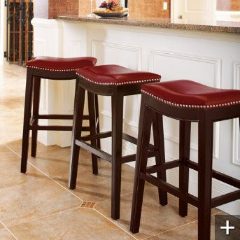 Red Saddle Style Bar Stools To Go With Pub Table